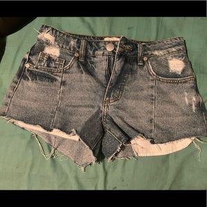 Cute distressed blue denim shorts
